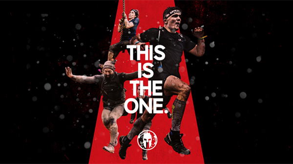 Spartan Race UK creative with This Is The One written over three people and red background. Earnie Creative Design.