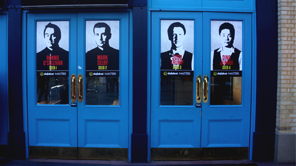 Photo of 4 doors at World Snooker Dafabet Masters with creative of players on doors. Earnie Creative design.
