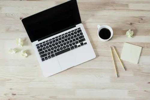 laptop paper pencil coffee