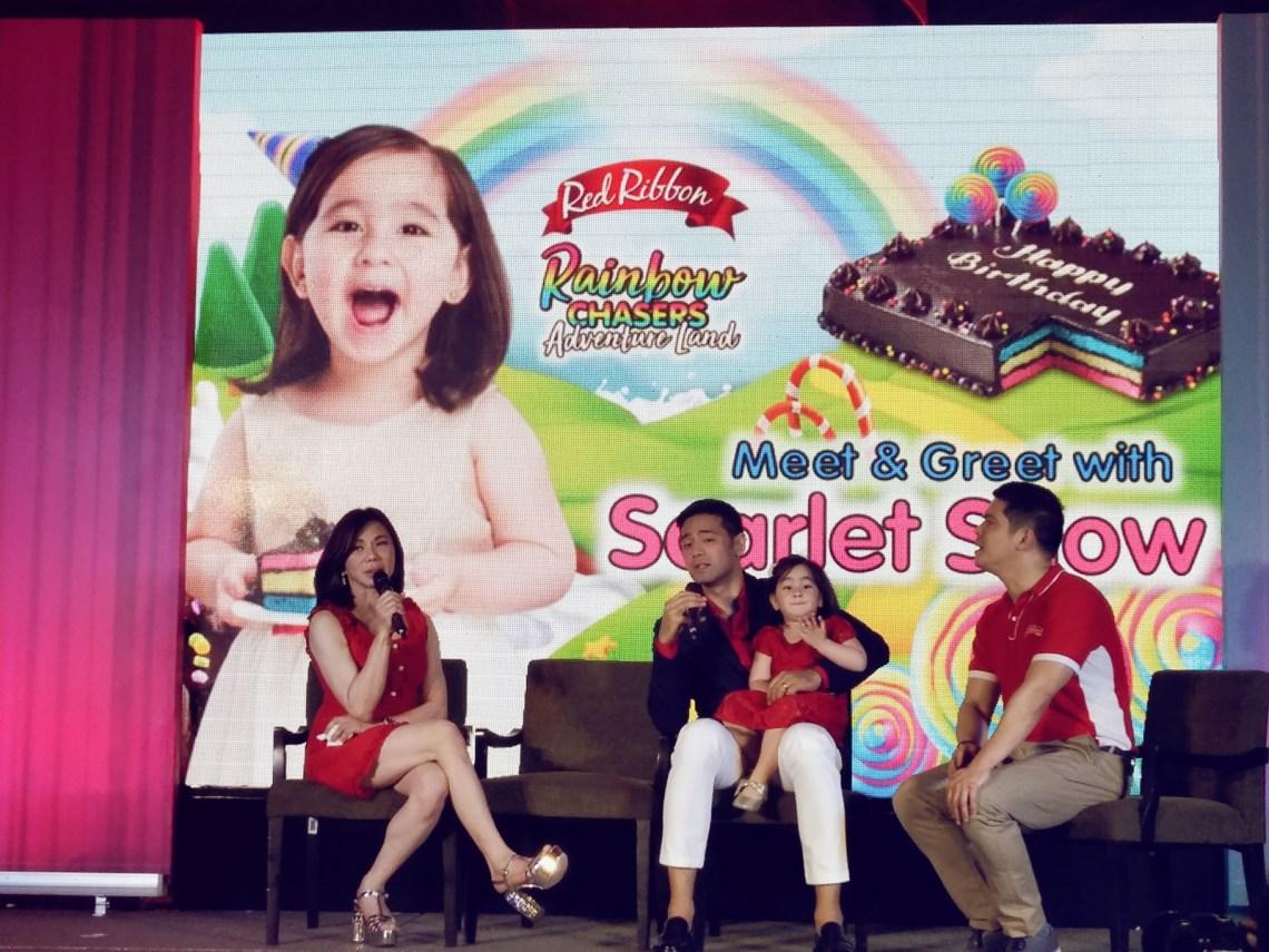 Scarlet Snow Belo-Kho Red Ribbon Rainbow Dedication Cake