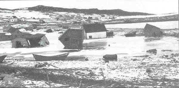 Several houses in Lord's Cove, Canada, displaced and toppled by the tsunami following the 1929 Grand Banks earthquake.