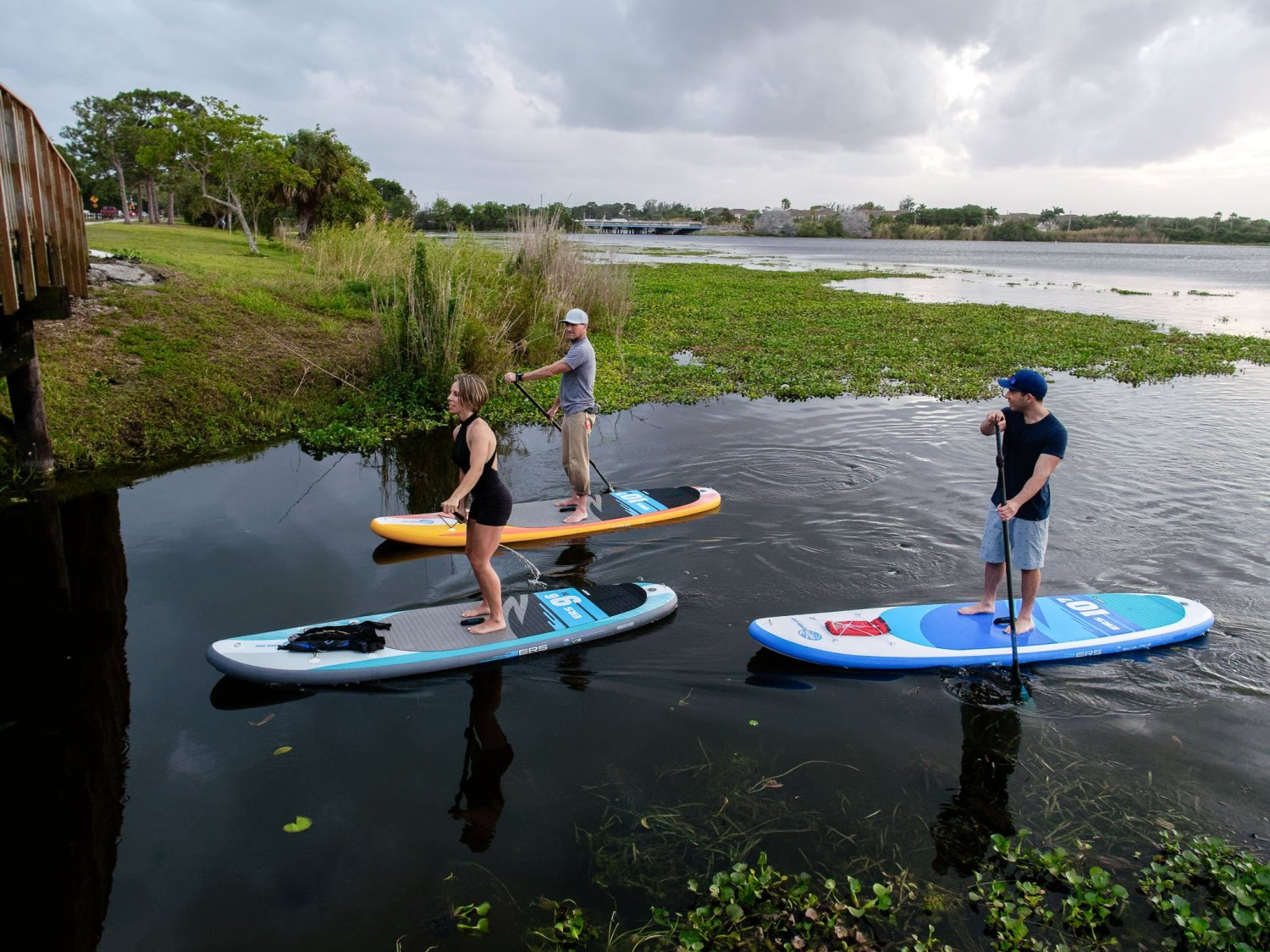 SUP paddlers on different size paddle boards