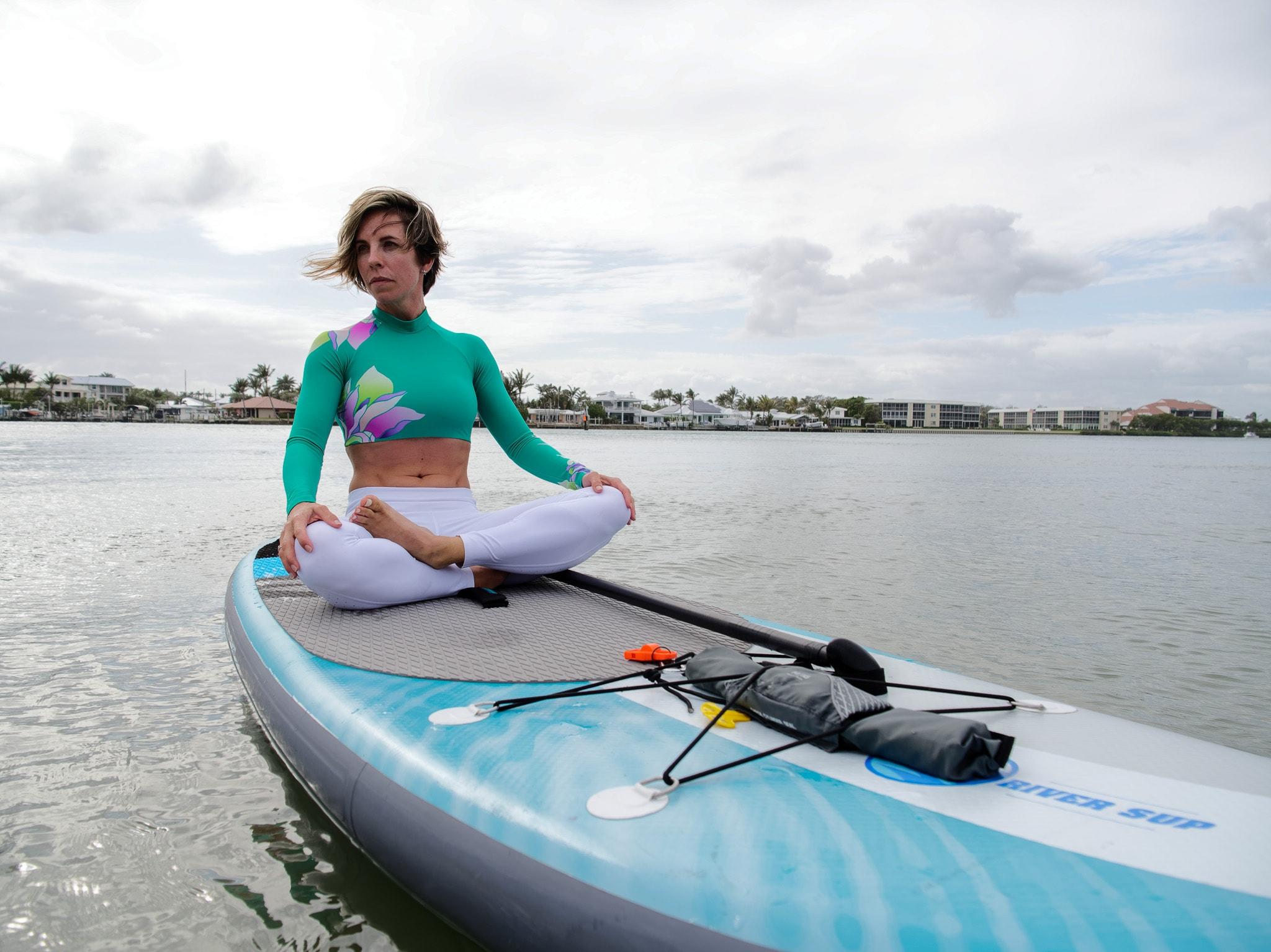 "girl paddling a lake on a 5"" SUP"