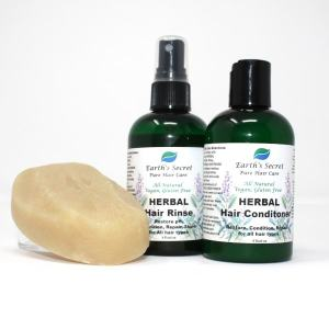 brown bottle of herbal hair rinse with spray top, brown bottle of conditioner, shampoo bar
