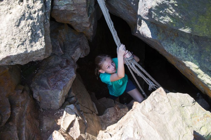 Kara, coming out of the top of the cave.