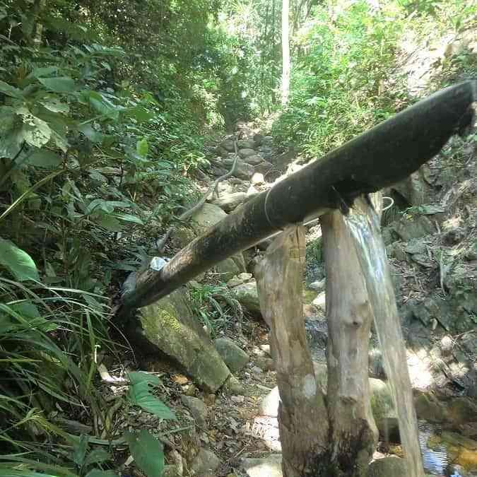 Ati shower in the jungle in Malay, Philippines.