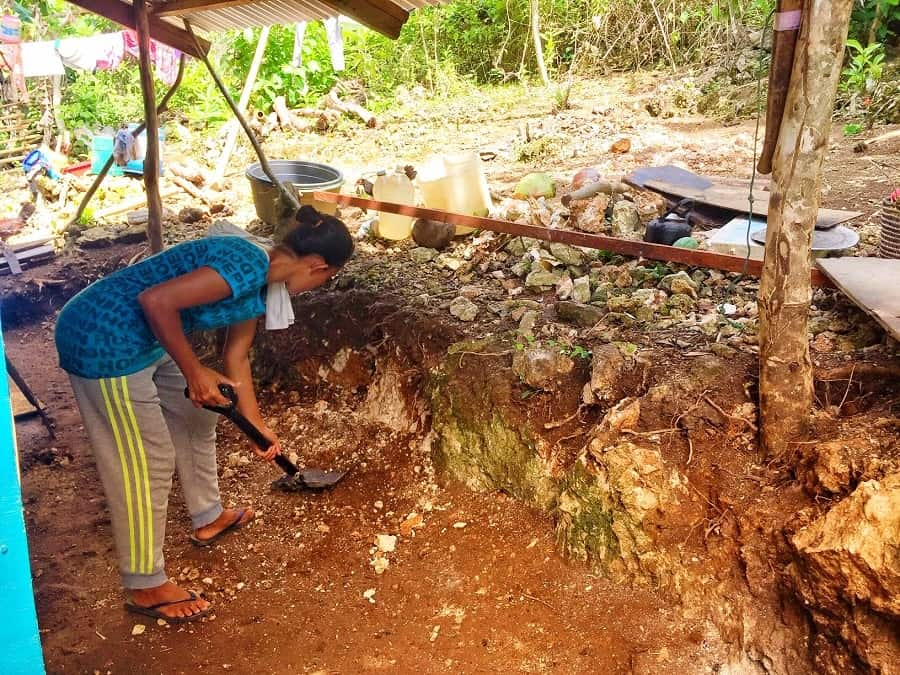 Widow works on her new small home in Naasug, Malay, Aklan, Philippines.