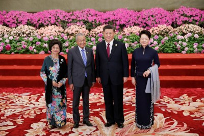 Malaysian Prime Minister Mahathir Mohamad and his wife arrive to attend a welcoming banquet for the Belt andRoad Forum hosted by Chinese President Xi Jinping and his wife at the Great Hall of the People in Beijing, China, 26 April 2019 (Photo: Reuters/Jason Lee/Pool).
