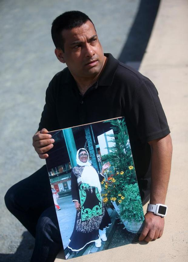 Tony Ahmed is photographed with a picture of his mother, Afroza Chowdhury on Monday, Feb. 29, 2016, in San Francisco, Calif. Chowdhury died when she jumped out of a taxi cab that was travelling at freeway speeds last year. (Aric Crabb/Bay Area News Group)