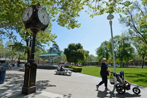 A pedestrian walks past the park clock at Todos Santos Plaza in Concord, Calif., on Saturday, April 12, 2014. City leaders say Concord is safer than it used to be and crime statistics show comparable or fewer incidents than in similarly sized nearby cities. (Jose Carlos Fajardo/Bay Area News Group)