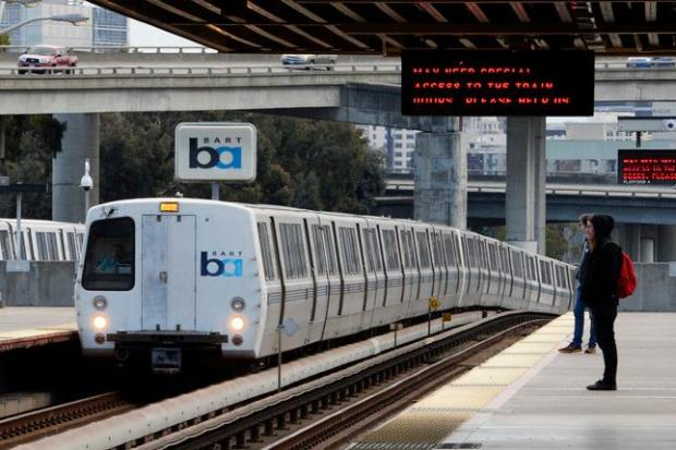 A BART train arrives at the MacAthur station in Oakland.