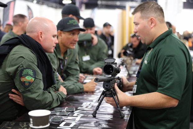 A firearms vendor talks to law enforcement officers about his products at the Urban Shield vendor show in 2015. (Alameda County Sherriff's Office)