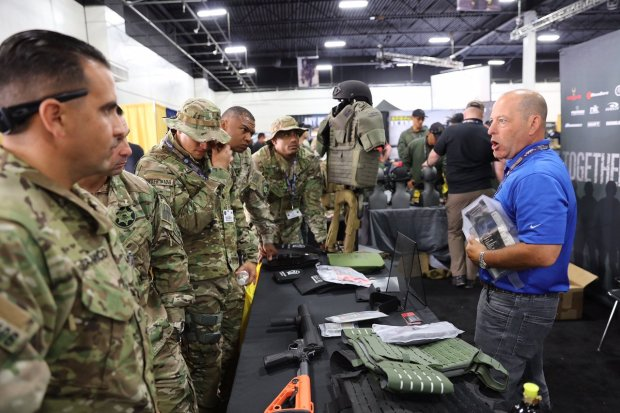 Emergency personnel look at firearms and protective gear at the Urban Shield vendor show in 2015. (Alameda County Sheriff's Office)
