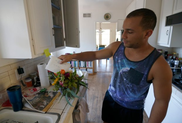 Micah Spalding, 22, received flowers and a card for his mother Carol Brown, who was shot twice during a robbery Monday night at their home in Orinda, Calif., on Tuesday, Sept. 27, 2016. Spalding's father Tom Spalding was pistol-whipped in the attack. Brown is in stable condition, and Spalding was treated and released. The suspects have not been apprehended. (Jane Tyska/Bay Area News Group)