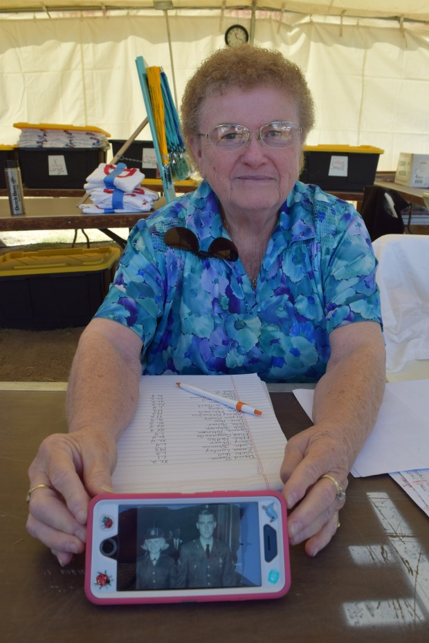 Connie Combs of Pleasanton, a volunter at East Bay Stand Down 2016, shows a photo of her wedding to husband Farel. They met while in the Army, assigned to Germany in 1965