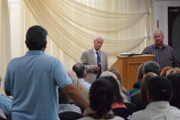 """San Ramon City Attorney Robert Saxe, left, and """"Stay the Course"""" member Scott Holder listen to a question from the audience at a Thursday night meeting of local residents concerned about keeping housing development off the golf course."""
