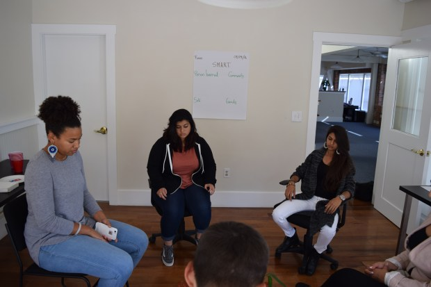 Rosy Corado-Biggs of Oakland, center, is flanked by Zuleika Lewis, left, and Fatimeh Khan, both of Community Works West, as they prepare for a restorative community conference with a young offender and his mother as part of the Oakland-based nonprofit's juvenile diversion program.