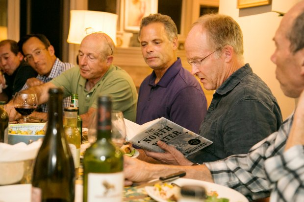 Doug VanGessel reads a passage from their current book during his critique at the dinner gathering of a Men's Book Club in San Rafael, Calif. Tuesday, September 27, 2016. (James Cacciatore/Special to the Marin Independent Journal)