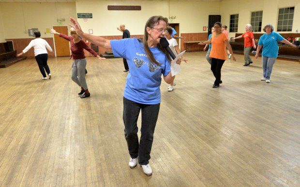 Dance instructor Lois Elling leads a clog dancing class during a Diablo Mountain Cloggers class held at the Danville Grange in Danville, Calif., on Wednesday, Sept. 28, 2016. The weekly class features two sessions of clog dancing, the beginning session followed by the club dances. Although the sessions include some traditional style clogging, most of the dancing is in the popular form of line dances. (Doug Duran/Bay Area News Group)