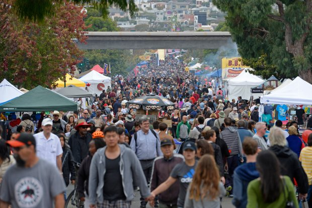 Thousands of visitors walk along Solano Avenue during the 42nd annual Solano Avenue Stroll in Albany, Calif., on Sunday, Sept. 11, 2016. The Solano Avenue Stroll is an annual street fair held on the second Sunday of September on Solano Avenue. Since 1974 The Solano Stroll closes down almost two miles of Solano Avenue with an estimated 250,000 participants and guests attended the event. (Jose Carlos Fajardo/Bay Area News Group)