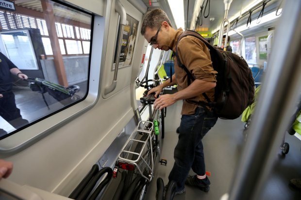 Kenji Yamada with Bike Concord tries out a bike rack on one of BART's new train cars at the Pleasant Hill station in Walnut Creek, Calif., on Saturday, Oct. 15, 2016. The agency is planning to replace its 669 train cars with 775 new ones, which will help expand capacity on the overcrowded system. (Anda Chu/Bay Area News Group)