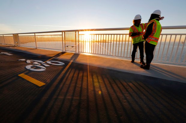 Caltrans spokesperson for the Bay Bridge Leah Robinson-Leach talks to a reporter on the new portion of the Bay Bridge bike path leading to Yerba Buena Island in San Francisco, Calif., on Thursday, Oct. 20, 2016. The bike path on the new Bay Bridge has been completed and will open this weekend allowing bicyclists, walkers and runners an open path from the East Bay to Yerba Buena Island and Treasure Island. (Laura A. Oda/Bay Area News Group)
