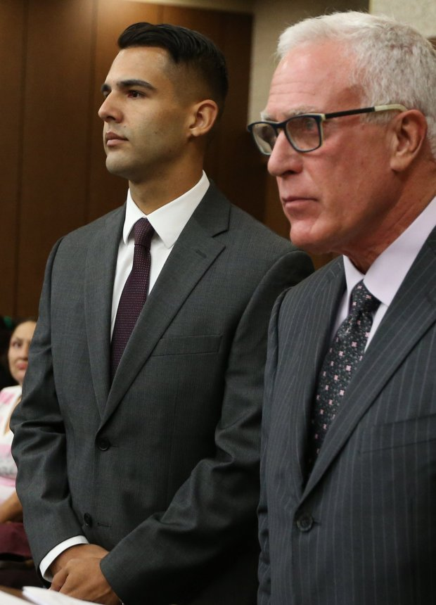 Former Oakland police officer Giovanni LoVerde, left, along with his attorney Michael Cardoza appear in court for an arraignment hearing at the Hayward Hall of Justice in Hayward, Calif., on Friday, Oct. 21, 2016. LoVerde pleaded not guilty to felony charges related to the sex exploitation scandal. (Anda Chu/Bay Area News Group)