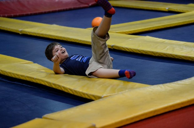 Ayden McCullouch, 9, of Walnut Creek, falls on the trampoline while playing dodge ball at Sky High Sports in Concord, Calif., on Tuesday, Oct. 11, 2016. Every Tuesday between the hours of 3-6 the trampoline park offers a special time just for special needs children. They dim the lights, turn off the music and in general dial down the distractions for the kids and their families. Owner Jerry Raymond, who is the father of a special needs child, in honor of the business' 10-year anniversary, during October will sell brightly colored, autism awareness themed jump socks with 100% of the proceeds benefiting Autism Speaks. They also limit attendance, but it is not limited to special needs children. (Dan Honda/Bay Area News Group)