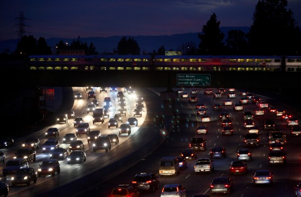 CalTrain speeds across rush hour traffic on Interstate 280 Wednesday evening, Feb. 10, 2016, into downtown San Jose, Calif. According to a Metropolitan Transportation Commission annual report, the commute along I-280 between South Jackson Avenue and Foothill Express way is the most congested commute in the south bay and the third worst overall in the Bay area. (Karl Mondon/Bay Area News Group)