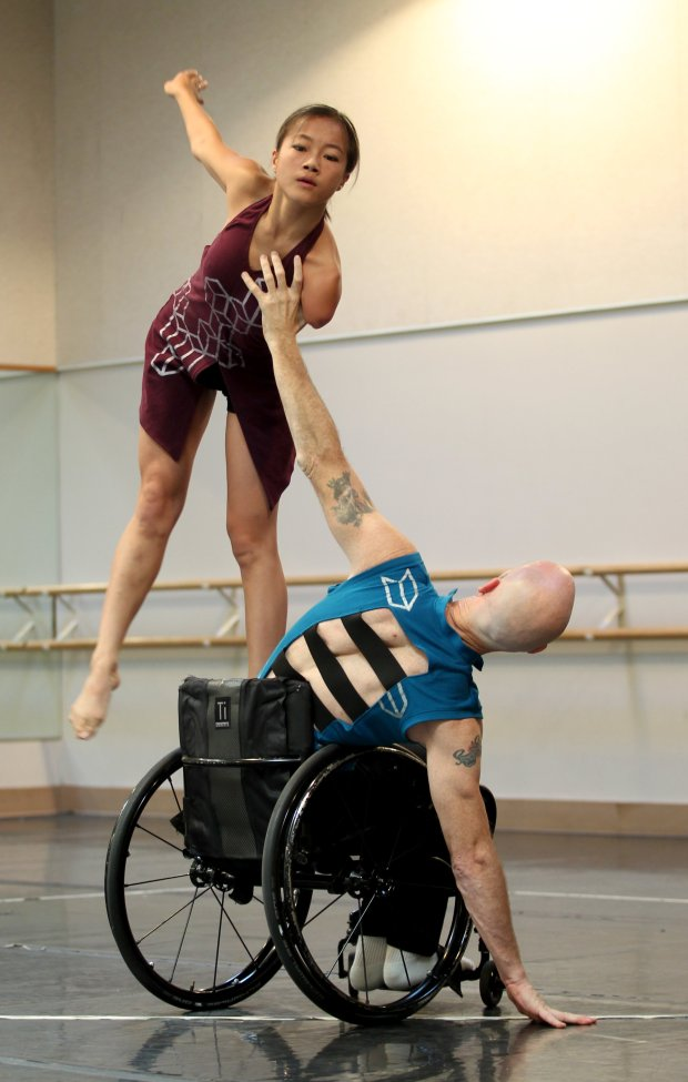 Dwayne Scheuneman, right, and Lani Dickinson dance during a recent free community performance by the Axis Dance Company an ensemble of performers with and without disabilities in Oakland, Calif., on Saturday, Oct. 29, 2016. Scheuneman, a veteran, has used physically integrated dance to help overcome his disability. (Anda Chu/Bay Area News Group)