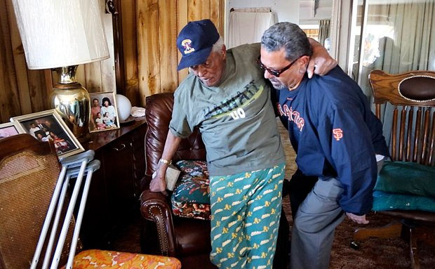 Meals on Wheels driver Raul Cardera helps Milton Williams, 95, get up out of his chair at his home in Oakland, Calif., after delivering him his meal on Wednesday, Nov. 16, 2016. Williams has been a recipient of the Meals on Wheels program for about ten years, allowing him to live at his home of 40 years. (Laura A. Oda/Bay Area News Group)