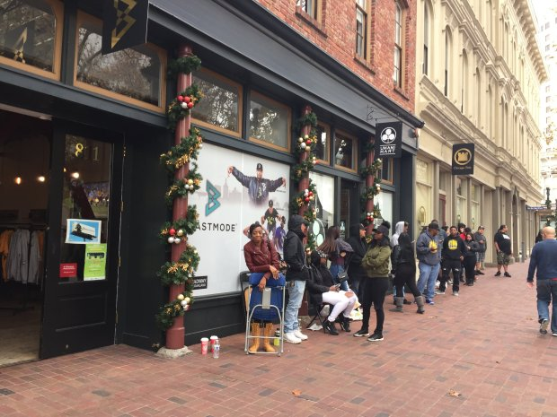 Fans lined up early at Beast Mode, former Seattle Seahawks running back Marshawn Lynch's clothing store, for meet and greet with Compton-based rapper YG, who released his limited edition $100 mix tape *Red Friday, *on Friday. (Aaron Davis/Staff)