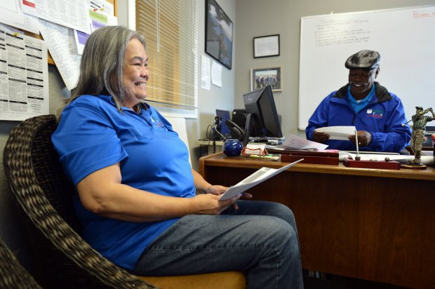 Maria Fortez, a graduate of the Bay Area Rescue Mission's Women's Discipleship Program, chats with Sherwin Harris, vice president of facilities renovation, at the organization's business office in Richmond, Calif., on Wednesday, Nov. 16, 2016. (Kristopher Skinner/Bay Area News Group)