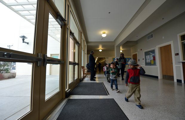 Children walk through the reception area as Nystrom Magnet Elementary School celebrates its recently renovated campus in Richmond, Calif., on Wednesday, Nov. 30, 2016. The renovations were funded as part of a massive bond program approved by West Contra Costa Unified School District voters starting in 1998. (Kristopher Skinner/Bay Area News Group)