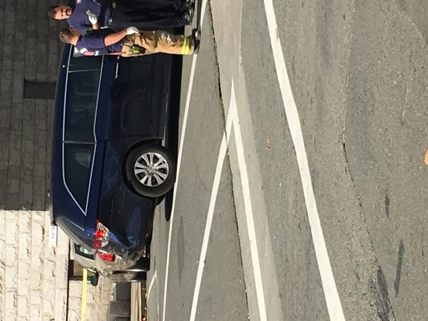 A driver struck a blue van shortly before hitting three pedestrians outside a Martinez courthouse on Monday. (Photo courtesy of Christina Parson)