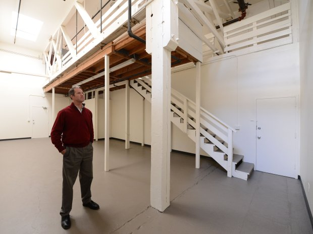 Owner Ted Peterson shows a vacant unit at the live-work building called The Boise in Oakland, Calif., on Tuesday, Dec. 20, 2016. After the tragic Ghost Ship fire, these types of buildings are getting more attention by the city and the public. The Boise is an example of a live-work warehouse style housing that is legitimate, safe and properly permitted. The Boise consists of two buildings, one with entrances off a common interior hallway, and one with exterior entrances to the units. Each unit has a fire resistant door and fire sprinklers. (Dan Honda/Bay Area News Group)