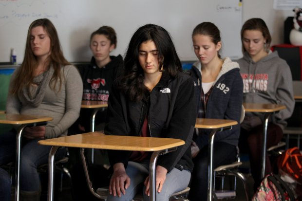 Students attend a 30-minute mindfulness session at Monte Vista high school in Danville, Calif., on Tuesday, Dec. 20, 2016. Allan Isbell a former substitute teacher at the school is helping students with the stress of finals week by teaching meditation and other relaxation techniques. (Anda Chu/Bay Area News Group)