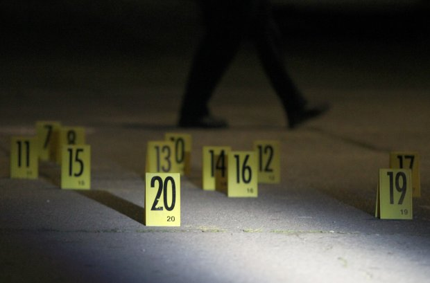 Evidence markers are photographed at the scene of an apparent fatal shooting at 88th Avenue and Hillside Street in Oakland, Calif., on Friday, Dec. 16, 2016. (Anda Chu/Bay Area News Group)
