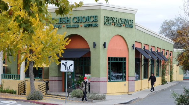 People walk past the now closed Fresh Choice restaurant in Walnut Creek, Calif., on Friday, Dec. 14, 2012. (Doug Duran/Staff)
