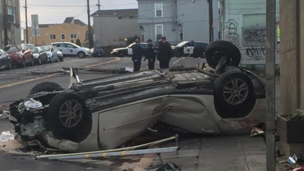 A rollover crash Monday, Dec. 12, in East Oakland injured one person, police said. (Amy Hollyfield/KGO-TV)