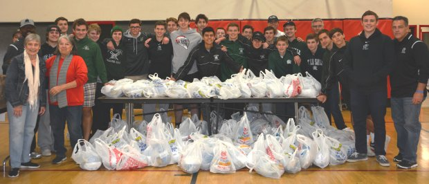 "De La Salle High School Lacrosse teams worked together to raise funds, and purchased 150 turkeys and food baskets for the St. Vincent de Paul Food Pantry at St. Francis of Assisi Church in Concord. The De La Salle Lacrosse program has ""teamed up"" with St. Vincent de Paul, and SVdP food coordinator Jane Streich, for the last six years, raising more than $13,000 and volunteering over 540 hours assisting in delivery of turkeys."