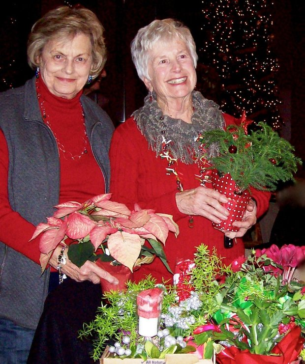 Pleasant Hill Garden Study Club members Carol Nelsen, left, and Gail Sutherland continued the group's holiday tradition by collecting 30 houseplants at their last club meeting and delivering them to homebound Hospice patients.