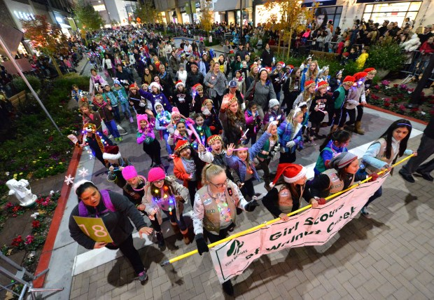 Girl Scouts from Walnut Creek walk down Broadway Plaza during the Holiday Parade of Lights, Open House & Tree Lighting in Walnut Creek, Calif., on Thursday, Dec. 1, 2016. (Doug Duran/Bay Area News Group)