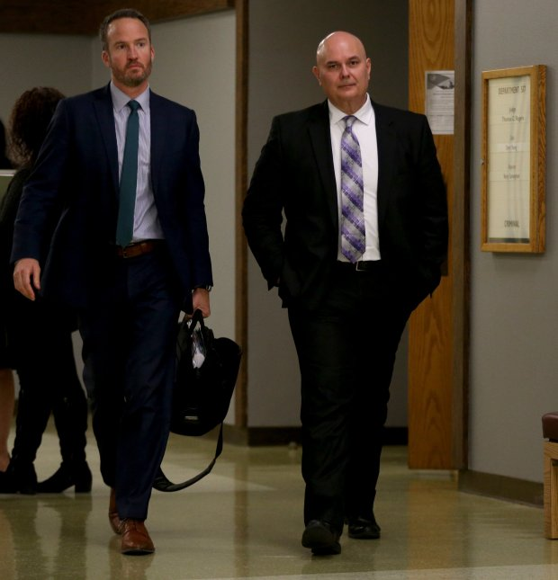 Retired Hayward police Sgt. Michael Beal, right, along with his attorney Austin Thompson walk down a hallway at the Hayward Hall of Justice in Hayward, Calif., on Tuesday, Jan. 2017. Beal is accused of defrauding a mentally ill woman he once arrested for prostitution out of nearly $500,000. (Anda Chu/Bay Area News Group)