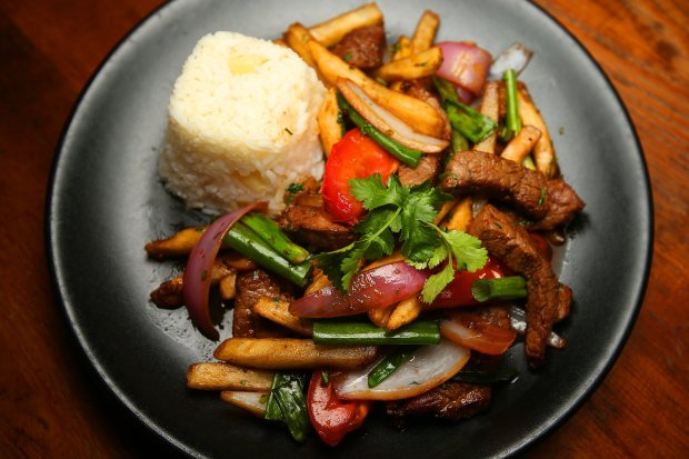 Lomo Saltado is photographed at LiMA on Tuesday, Jan. 3, 2017, in Concord, Calif. The dish consists of sauteed beff tenderloin, onions, tomato, garlic, and fries, tossed with a soy demi-glaze and side of rice. (Aric Crabb/Bay Area News Group)