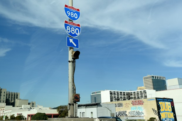 "Signage helps motorist weave their way through the downtown Oakland, Calif., area on Monday, Jan. 30, 2017. The Congress for the New Urbanism, an urban design advocacy group, is expected to release its triennial ""Freeways Without a Future"" report, identifying the top ten freeways nationwide that should be torn down and I-980 is expected to be on the list. (Susan Tripp Pollard/Bay Area News Group)"