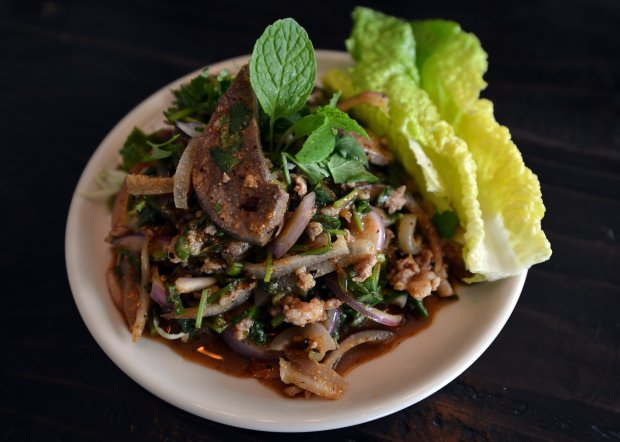 The Larb pork dish awaits a diner at Larb Thai Food & Tapas restaurant in El Cerrito, Calif., on Monday, Jan. 9, 2017. The restaurant recently opened in the Peppermint Tree Plaza on San Pablo Ave. (Kristopher Skinner/Bay Area News Group)