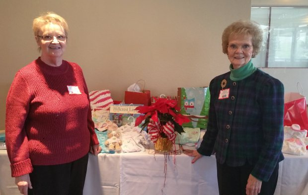 Hillcrest Congregational Church of Pleasant Hill office manager Kathy Flagstead, left, welcomed layette gifts from the Clayton Valley Woman's Club for the layette program, from CVWC president Connie Weimar. Hillcrest has provided more than 20 layettes a month for more than 50 years to the Contra Costa Public Health Nursing service. (Courtesy of Michele Pryor)