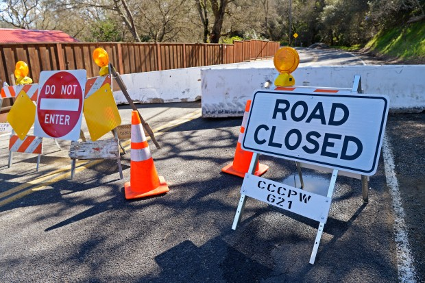 A sign warns motorist that Morgan Territory road is closed due to a mudslide in Contra Costa County, Calif. on Monday, Feb. 27, 2017. The mudslide occurred after recent rains forcing the closure and access for residents. Residents are forced to park about a mile away and carry bottled water to their home. (Jose Carlos Fajardo/Bay Area News Group)