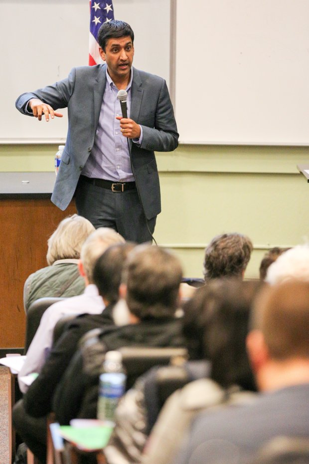 U.S. Rep. Ro Khanna speaks to a crowd of hundreds at his first town hall asan elected official on Wednesday night at Ohlone College in Fremont. Hundreds more attendees were sent to an overflow room on campus. Photo by Joseph Geha.